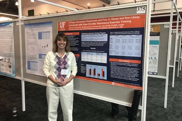 Dr. Heather Vincent Standing in front of Research Poster