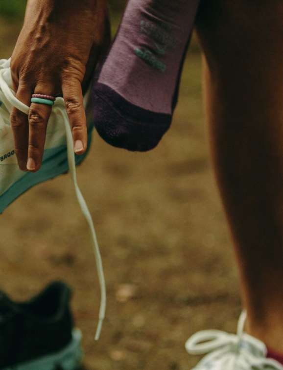 Photo of female putting on running shoe.  Photo credit to DAVID JAEWON OH